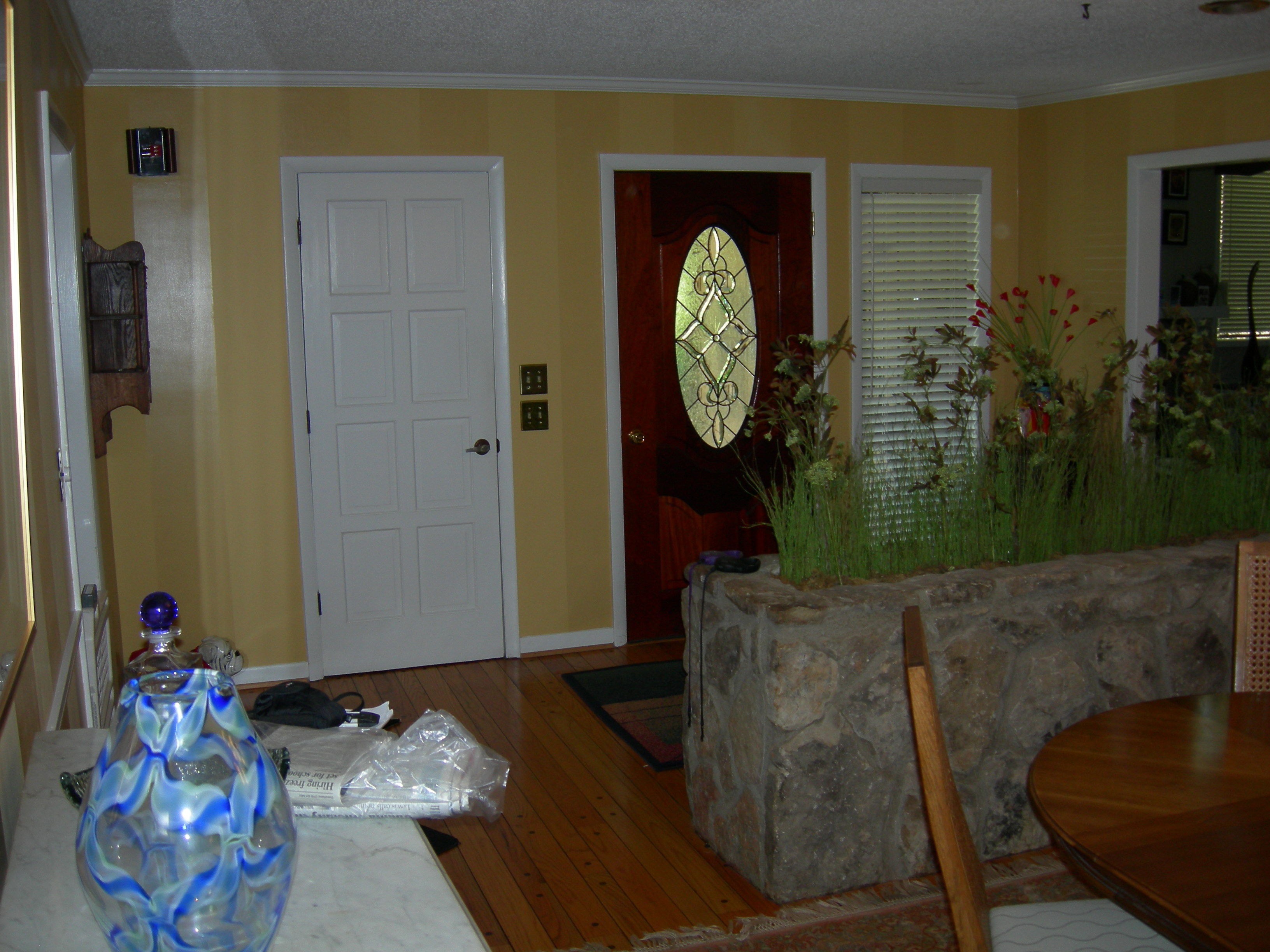 Before View Of The Entry And Front Door After From Dining Room