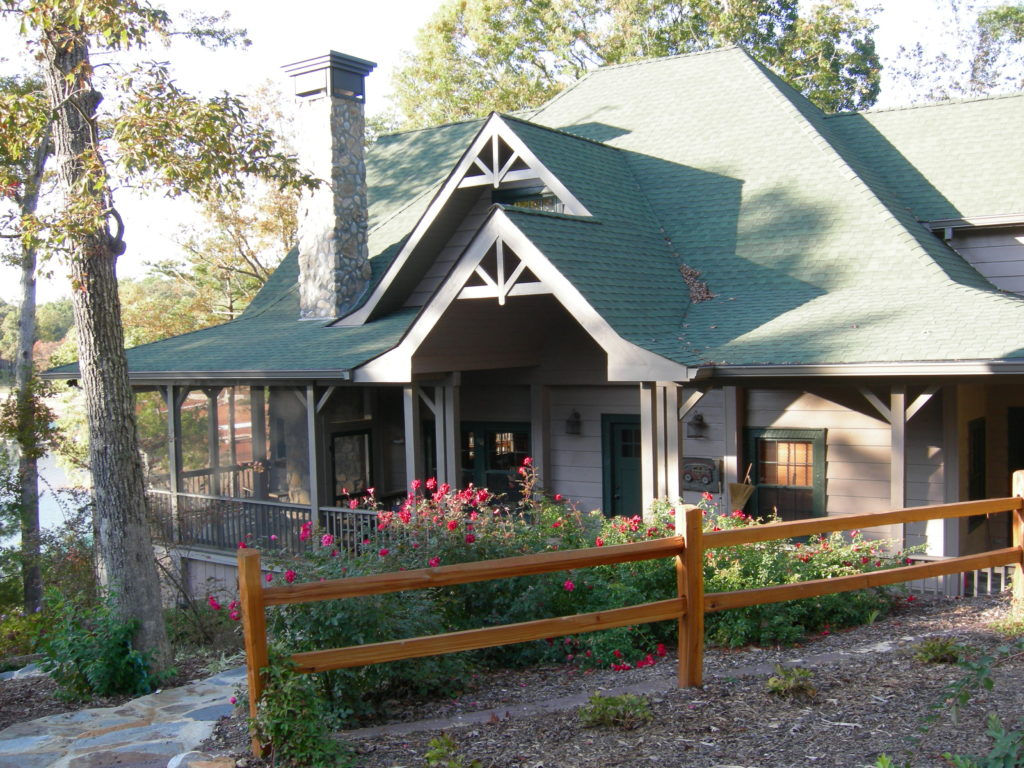 Remodeled cabin front entry with wooden post fence