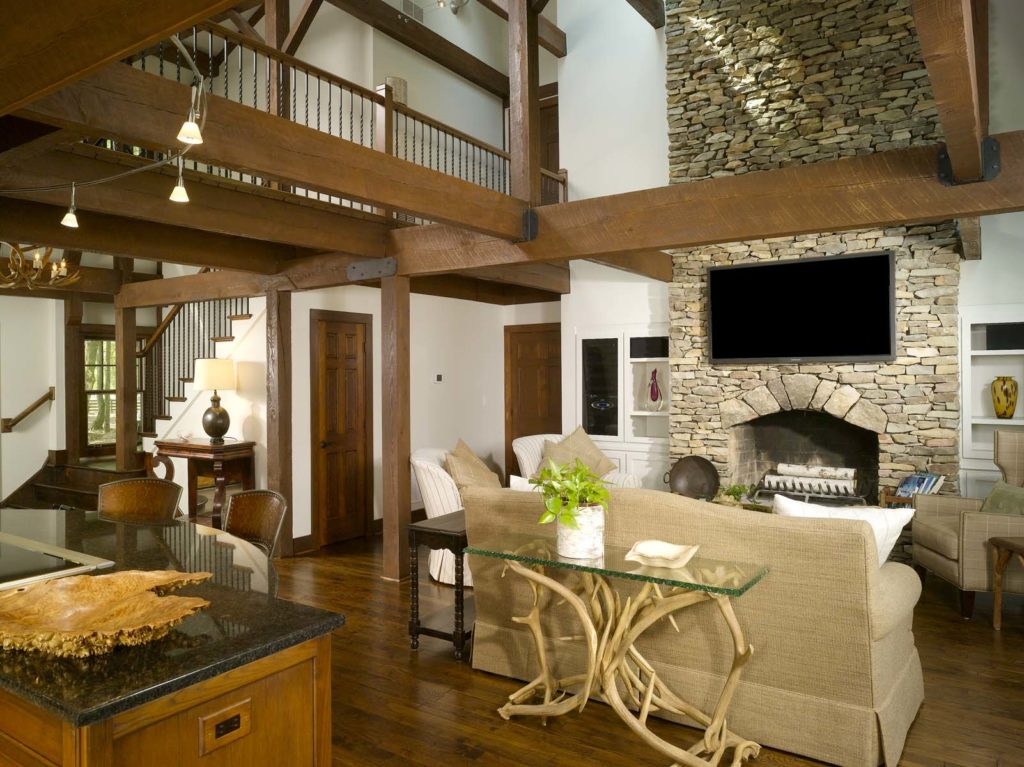 Wood-burning fireplace in lodge with post and beam construction