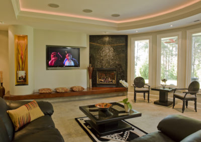 Gas log fireplace with granite face and walnut hearth in contemporary style living room