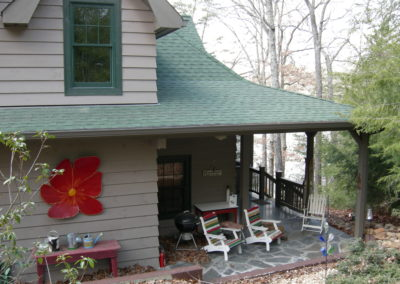 Patio view of remodeled cabin in woods