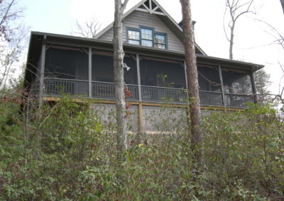 Remodeled cabin with screened porch and second story addition