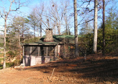 A dilapidated cabin in the middle of Georgia woods landscape