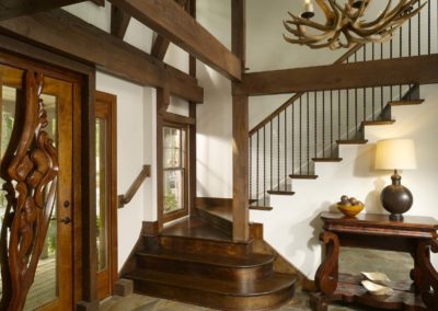 View of contemporary Lodge entry and front door with decorative wooden trim