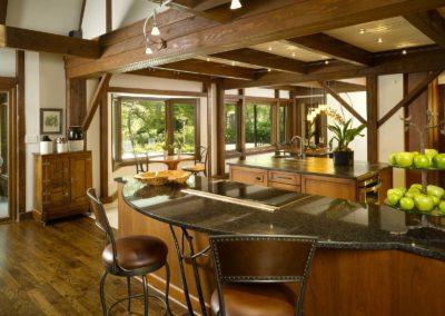 Contemporary lodge kitchen with wooden beams and black granite countertops