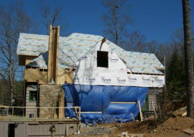 In progress construction of lakeside cabin