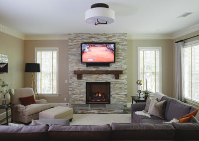 Fireplace with stone tile face in terrace level sitting room